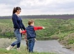 28745522-little-boy-pointing-to-something-in-the-countryside-showing-his-mother-a-point-of-interest-as-they-s