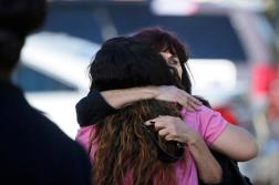 Teresa Hernandez, facing camera, is comforted by a woman as she arrives at a social services center in San Bernardino, Calif., where one or more gunmen opened fire, shooting multiple people on Wednesday, Dec. 2, 2015. (AP Photo/Jae C. Hong)
