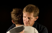 dad-comforts-son