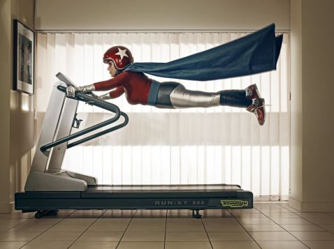 A-funny-photo-by-Sacha-Goldberger-of-his-grandmother-in-a-superhero-outfit-flying-on-a-treadmill