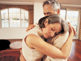 Mature Couple Embracing in Their Apartment
