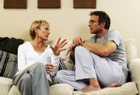 photolibrary_rf_photo_of_couple_talking_on_sofa