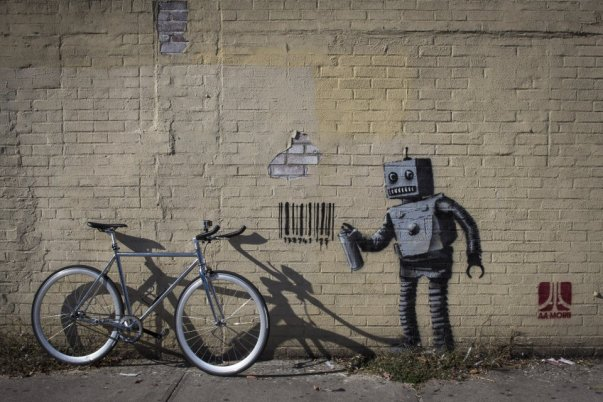 this-robot-graffiti-artist-tagging-a-wall-with-a-barcode-what-else-was-part-of-bankys-well-publicized-and-shadowy-residency-in-new-york-c