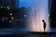 Boy at fountain's edge