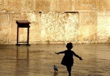 Girl chasing pigeon