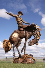 Scrap sculpture made from farm parts, musical instruments, etc. (by John Lopez)