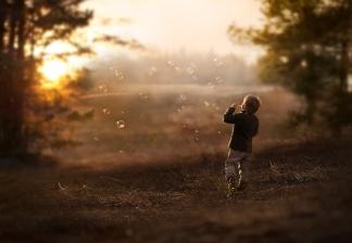 Boy blowing bubbles (Elena-Shumilova)