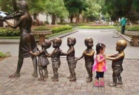 Kid dances with statue
