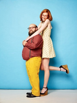 Tall woman and short man embracing