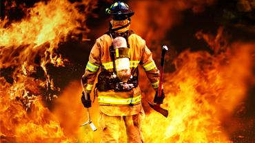 brave-firefighter-facing-a-huge-fire