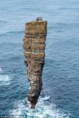 Climbers atop The Castle in Orkney, England