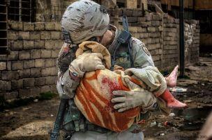Major Mark Bieger with injured Iraqi child