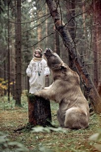 This Russian girl's family have raised her alonside their pet grizzly bear (photo by Olga Barantseva).