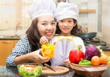 depositphotos_113975002-stock-photo-asian-mother-teaching-daughter-making