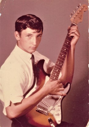 Mitch with guitar at age 14