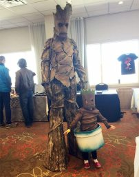 Dad and kid as Groot and Baby Groot