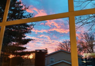 Early spring sunrise from our bedroom window - photo by Mitch Teemley