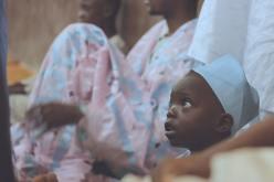 'Child at the Ceremony' by Oshomah Abubakar (unsplash.com)