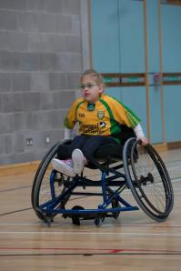 'Young girl in sports wheelchair,' Donegal, Ireland, by Danny Nee (unsplash.com)
