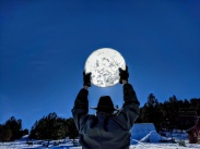 Holding the Moon (actually, a piece of glass with the sun behind it) - nickedemous77 (reddit.com)