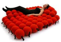 Resting can be a ball--in fact, it can be a hundred of them! (neatorama.com)